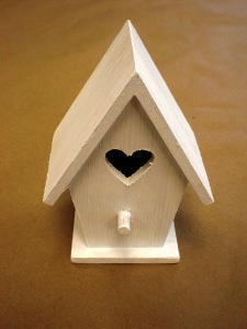 Sand the birdhouse smooth with fine grit sandpaper.