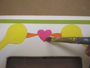 Paint the beaks and heart.