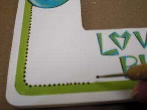 Paint a line border of mini black dots.