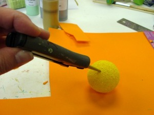 Use scissors to cut a slit for the chick's beak.
