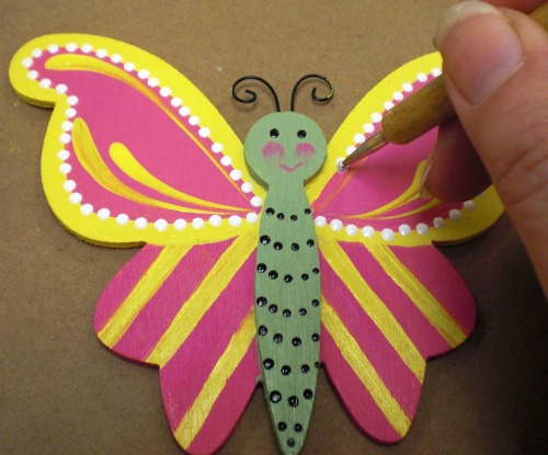Highlight the upper wings with White polka dots.