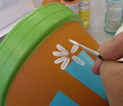 Use a round brush to add petals.