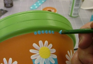 Create dot pattern using the opposite end of the paint brush.