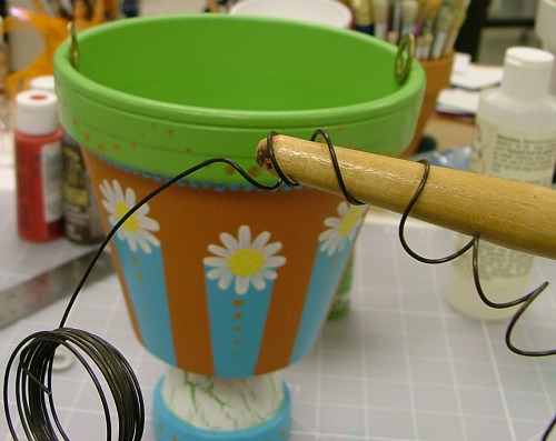 Wrap wire around a paint brush to curl.