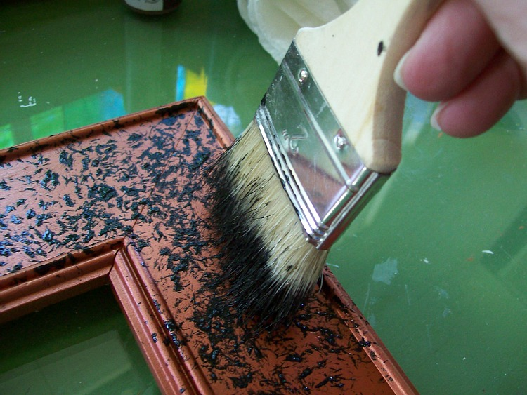 Stipple the paint mixture onto the frame.