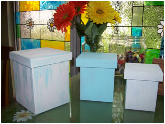 Add a top coat of paint to the boxes. When dry, lightly sand to create the aged look.