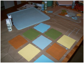 Basecoat the tile board and tiles.