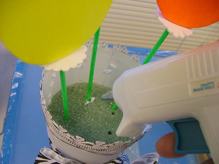 Insert flowers in to styrofoam.